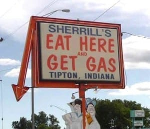 "Sign reads: ""eat here and get gas"""