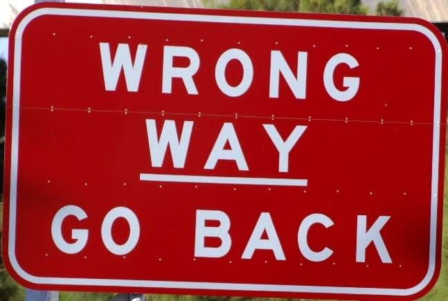 Sign saying you are going the wrong way, barking up the wrong tree