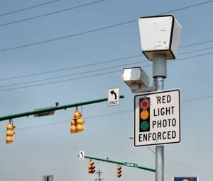 "Sign reads: ""red light photo"" the camera is covered though"