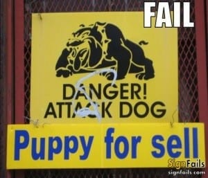 "Sin reads: ""danger attack dog"" followed by ""puppy for sale"""