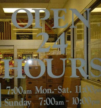 "Sign reads: ""open 24 hours"" but then has opening times underneath"