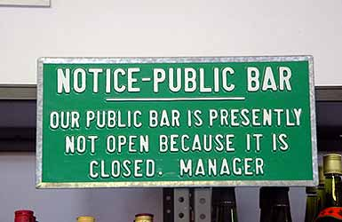 "Sign reads: ""our bar is currently not open because it is closed"""