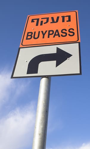 Funny spelling mistake on a sign: reads buypass instead of bypass