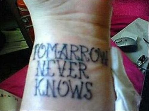 "Tattoo reads ""tomarrow never knows"""
