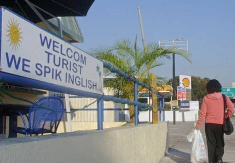 "Funny spelling mistake on sign reads: ""welcom turist we spik inglish"""