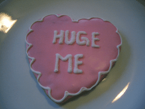 "Cake reads: ""huge me"""