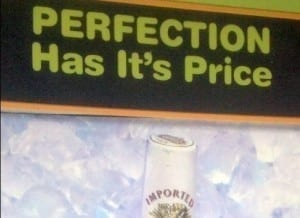"Sign reads: ""perfection has it's price."""