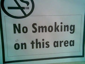 "Sign reads: ""no smoking on this area."""