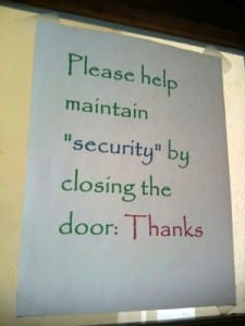 "Reads: please maintain ""security"" by closing the door"