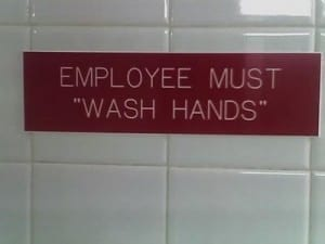 "Reads: Employee must ""wash hands"""