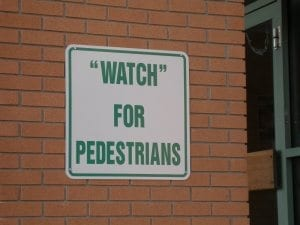 "Reads: ""Watch"" for pedestrians"