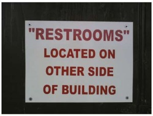 "Reads: ""restrooms"" are located on the other side of the building"