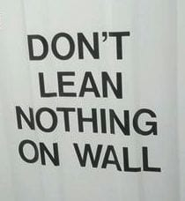 "Reads: ""Don't lean nothing on wall"""
