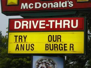 Sign reads Anus burger instead of angus burger