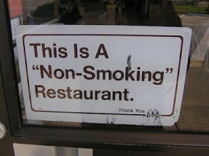 "Sign reads: ""this is a 'non-smoking' restaurant"""