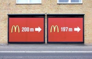 Two Mcdonalds signs side by side give incorrect information