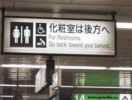 "Sign reads: ""go back toward your behind"""
