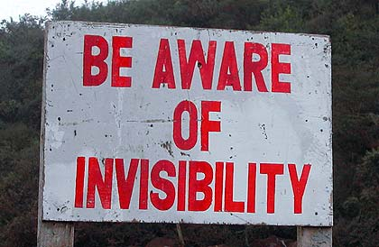 "Sign reads: ""be aware of invisibility"""