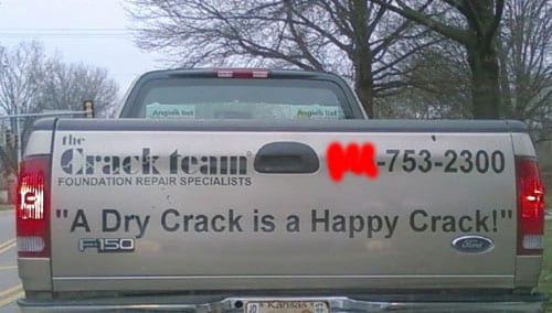 "Sign reads: ""a dry crack is a happy crack"""