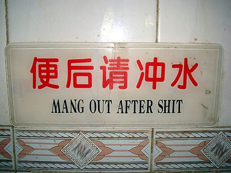 """Sign reads: """"mang out"""""""